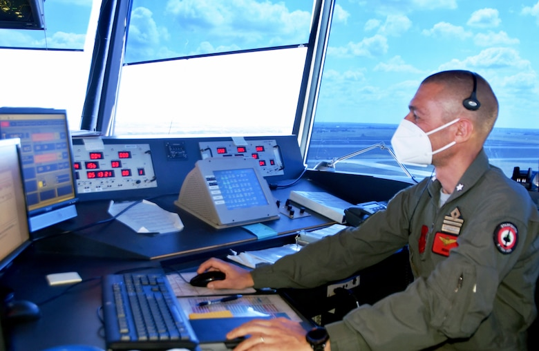 Lt. Col. Enrico Luisi monitors incoming and outbound flights inside the air traffic control tower