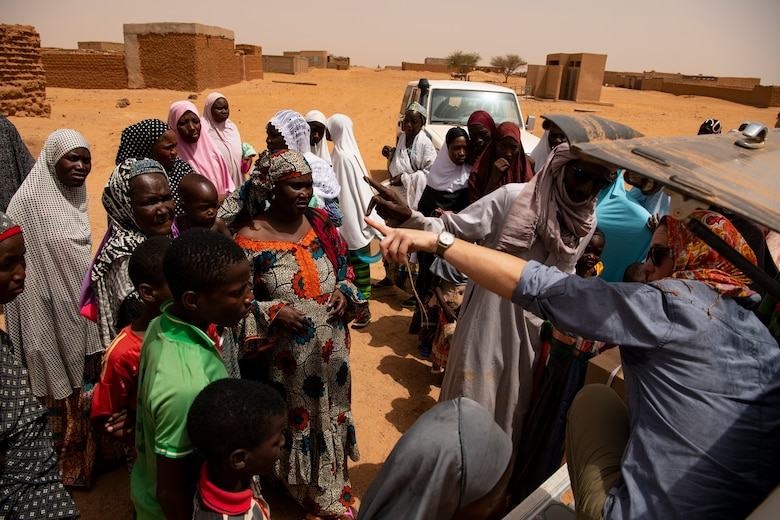 U.S. Airmen and Soldiers from Air Base 201 remove donated supplies for local Nigeriens at a village in Agadez, Niger, June 27, 2019. leave the base weekly to build partnerships with their host nation and its citizens.(U.S. Air Force photo by Tech. Sgt. Perry Aston) (U.S. Air Force photo by Tech. Sgt. Perry Aston)