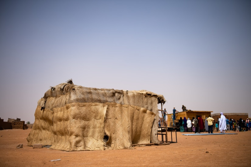 Wooden sticks and thatched roofing make up a classroom at a village in Agadez, Niger, June 27, 2019. The 724th Expeditionary Air Base Squadron civil engineer flight built the locals a new classroom made from stronger material and a tin roof to withstand the harsh conditions in Agadez. (U.S. Air Force photo by Staff Sgt. Devin Boyer)