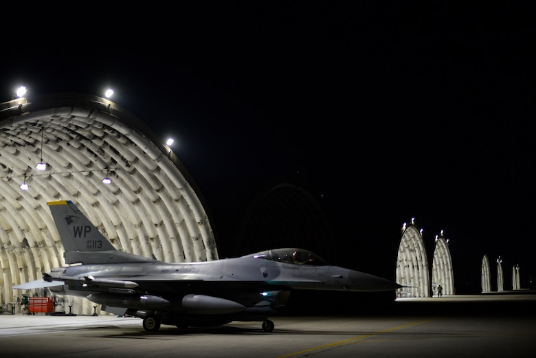 A jet leaves a shelter.
