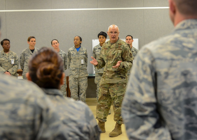 Gen. Arnold Bunch Jr., Commander, Air Force Materiel Command, talks with members of the 412th Medical Group during his visit to Edwards Air Force Base, California, Oct. 18. (U.S. Air Force photo by Giancarlo Casem)