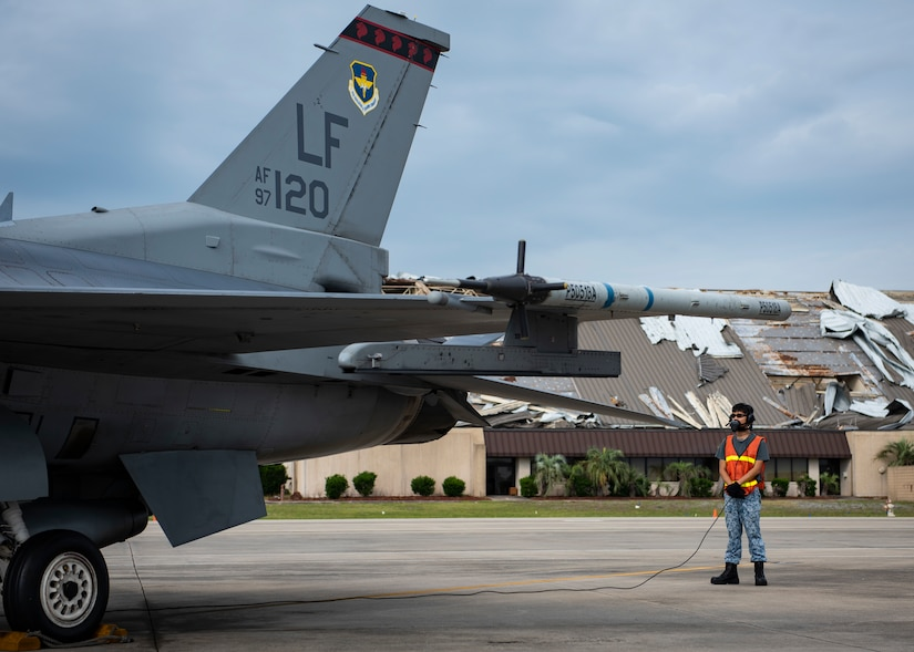 A Republic of Singapore air force F-16 Fighting Falcon fighter aircraft tactical aircraft maintainer assigned to the 425th Fighter Squadron, Luke Air Force Base, Arizona, performs a launch inspection June 10, 2019, on the flightline at Tyndall Air Force Base, Florida. The 425th FS is at Tyndall to take part in a Combat Archer exercise. (U.S. Air Force photo by Airman 1st Class Bailee A. Darbasie)