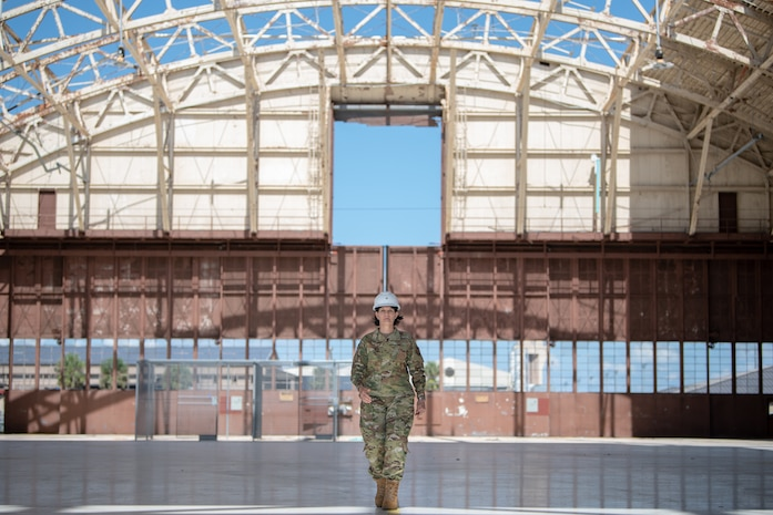 Brig. Gen. Patrice A. Melancon, Tyndall Air Force Base Reconstruction Program Management Office executive director, walks through Hanger Five at Tyndall Air Force Base which had to be completely demolished and will be replaced with a facility built with technology supporting fifth-generation fighters.