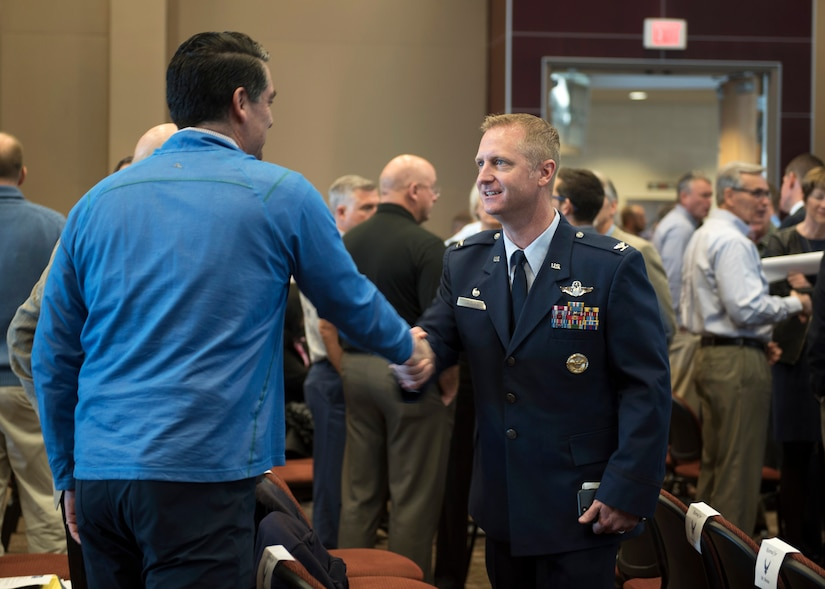 Col. Brian Laidlaw, 325th Fighter Wing commander, speaks with a Tyndall Industry Day attendee Jan. 31, 2019, at Florida State University in Panama City, Fla. Air Force, state leaders and industry professionals came together to discuss the current state and rebuild plan for the base, a plan that aims to reshape Tyndall into the Air Force's premiere base of the future. (U.S. Air Force photo by Tech. Sgt. Alexander Martinez)