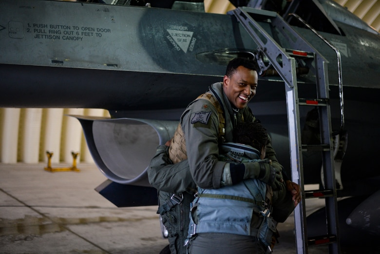 Two Airmen share a hug.
