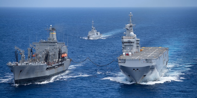 PHILIPPINE SEA (May 19, 2021) - The U.S. Navy's fleet replenishment oiler USNS Big Horn (T-AO 198), left, conducts an underway replenishment with the French Navy's amphibious assault ship FS Tonnerre (L 9014), while the French frigate FS Surcouf (F711) follows. (Photo courtesy of the French Navy)