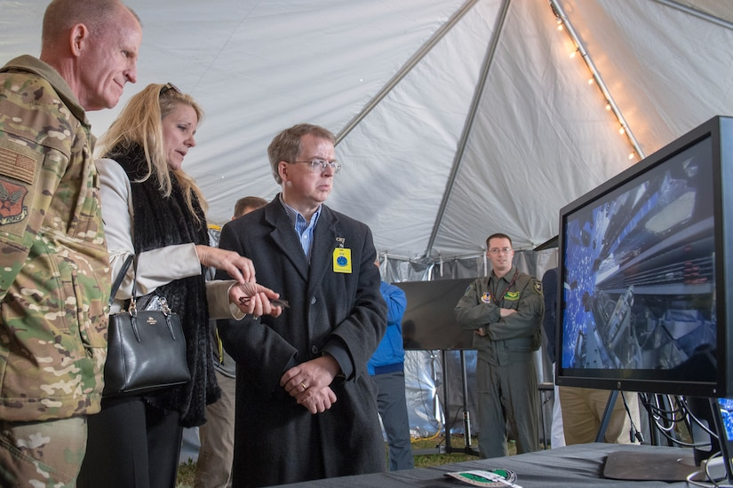 Gwynne Shotwell (center), SpaceX Chief Operating Officer, briefs Gen. Stephen W. Wilson, Vice Chief of Staff of the United States Air Force (left) and David Norquist, Deputy Secretary of Defense, on SpaceX capabilities during the Advanced Battle Management System (ABMS) demonstration at Eglin Air Force Base, Fla., Dec. 18, 2019. During this week's first demonstration of the ABMS, operators across the Air Force, Army, Navy and industry tested multiple real time data sharing tools and technology in a homeland defense-based scenario enacted by U.S. Northern Command and enabled by Air Force senior leaders. The collection of networked systems and immediately available information is critical to enabling joint service operations across all domains.(U.S. Air Force photo by Tech. Sgt. Joshua J. Garcia)