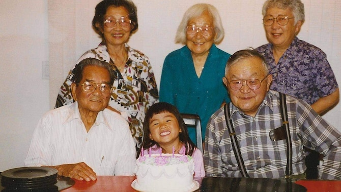 Ben and Cippy Parcasio, Eva Urabe, Mae and Roy Sakasegawa, and Capt. Heather Parcasio take a group photo in Salinas, California, in 1996. (U.S. Air Force courtesy photo)