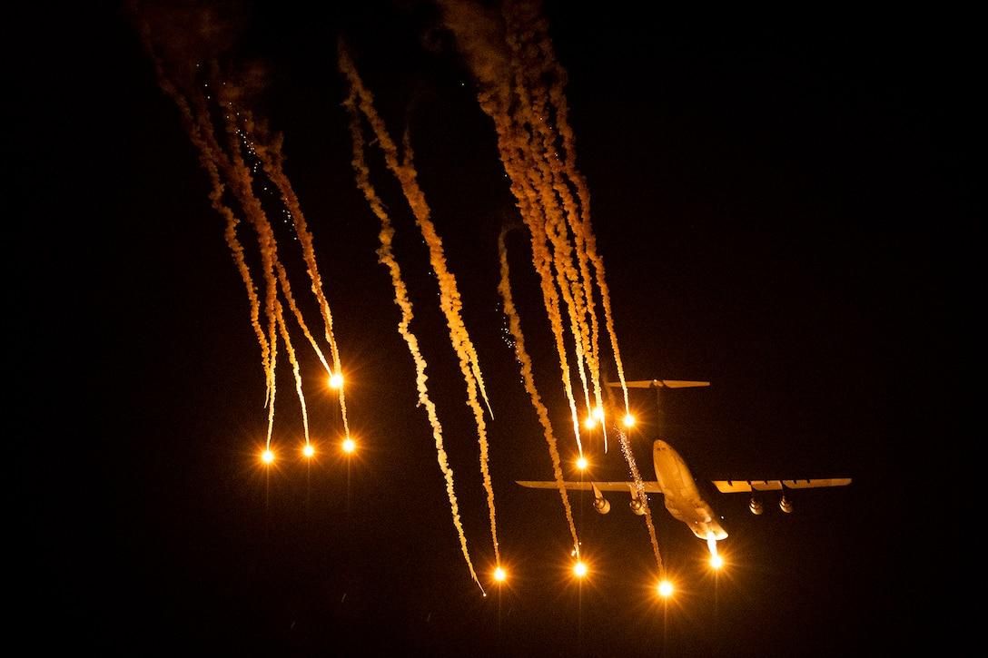 A 436th Airlift Wing C-5M Super Galaxy releases flares during a test May 12, 2021, at Eglin Air Force Base, Fla. The Dover AFB aircraft and aircrew released the flares as part of a two-week defensive countermeasures test program with the 46th Test Squadron.