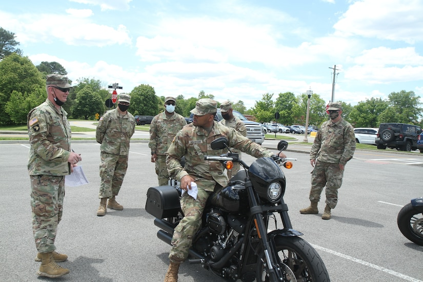 soldier sits on motorcycle