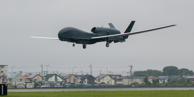 An RQ-4 Global Hawk, assigned to the 4th Reconnaissance Squadron, 319th Operation Group, Andersen Air Force Base, Guam, lands at Yokota Air Base, Japan, May, 22, 2021, for a rotational deployment. The movement maintains operations for Global Hawks during months of inclement weather on Guam. (U.S. Air Force photo by Yasuo Osakabe)