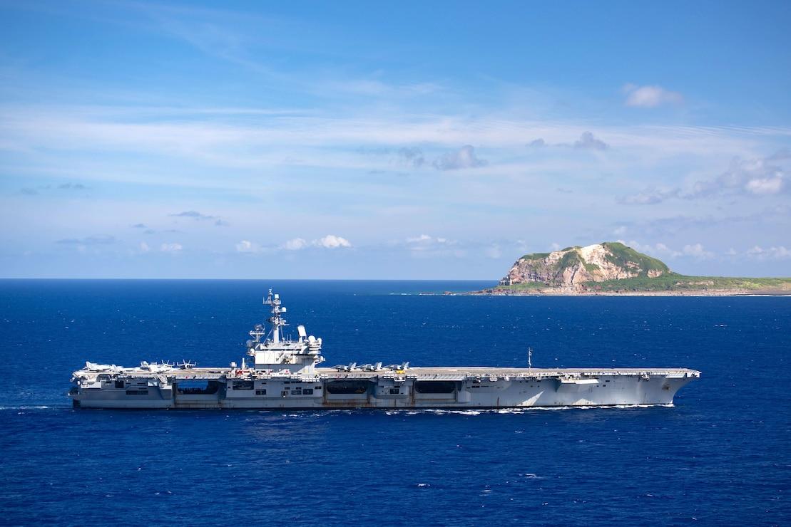 USS Ronald Reagan (CVN 76) steams off the coast of Iwo To.