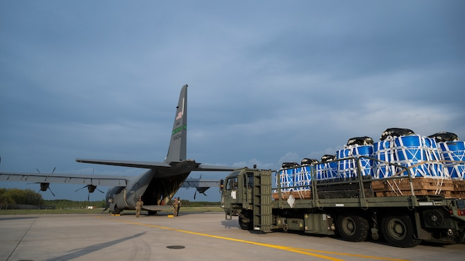 Airmen prepare to load container delivery systems