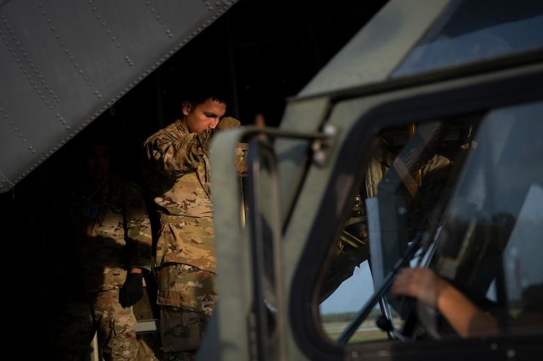 An Airman guides a K-loader