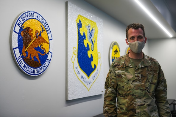 U.S. Air Force Col. Jason Richter, 31st Medical Support Squadron commander, poses for a photo at Aviano Air Base, Italy, May 19, 2021. Each year the American Hospital Association Special Achievement Award recognizes a federal health care leader who distinguished themselves through significant or innovative achievements and leadership that has contributed substantially to the mission of the federal health systems. (U.S. Air Force photo by Senior Airman Ericka A. Woolever)