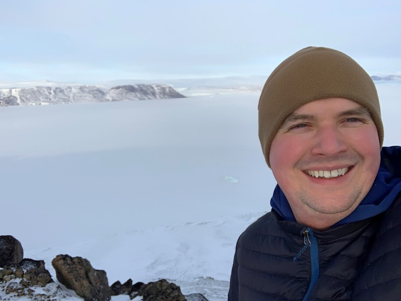 Chaplain (1st Lt.) Matthew Lanham, shown in front of the Wolstenhome Fjord, is the Individual Mobilization Augmentee to the installation chaplain at Thule Air Base, Greenland. (Courtesy photo)