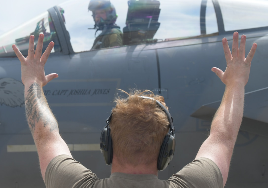 U.S. Air Force Senior Airman Brian Jankowski, 748th Aircraft Maintenance Squadron crew chief, marshals an F-15C Eagle assigned to the 493rd Fighter Squadron during exercise Astral Knight 21 at Larissa Air Base, Greece, May 20, 2021. The 48th Fighter Wing deployed 12 F-15C/D Eagles and more than 250 Airmen from the 493rd FS, 748th AMXS and other supporting units to participate in the exercise. (U.S. Air Force photo by Tech. Sgt. Alex Fox Echols III)