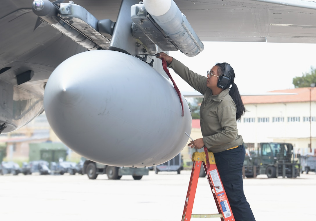 U.S. Air Force Airman 1st Class Amy Phanthavong, 493rd Aircraft Maintenance Squadron weapons load crew member, disarms munitions on an F-15C Eagle assigned to the 493rd Fighter Squadron during exercise Astral Knight 21 at Larissa Air Base, Greece, May 20, 2021. Astral Knight is a multinational, integrated air and missile defense exercise conducted in the Adriatic Region of Europe designed to enhance interoperability between the U.S. and its NATO allies in the region. (U.S. Air Force photo by Tech. Sgt. Alex Fox Echols III)