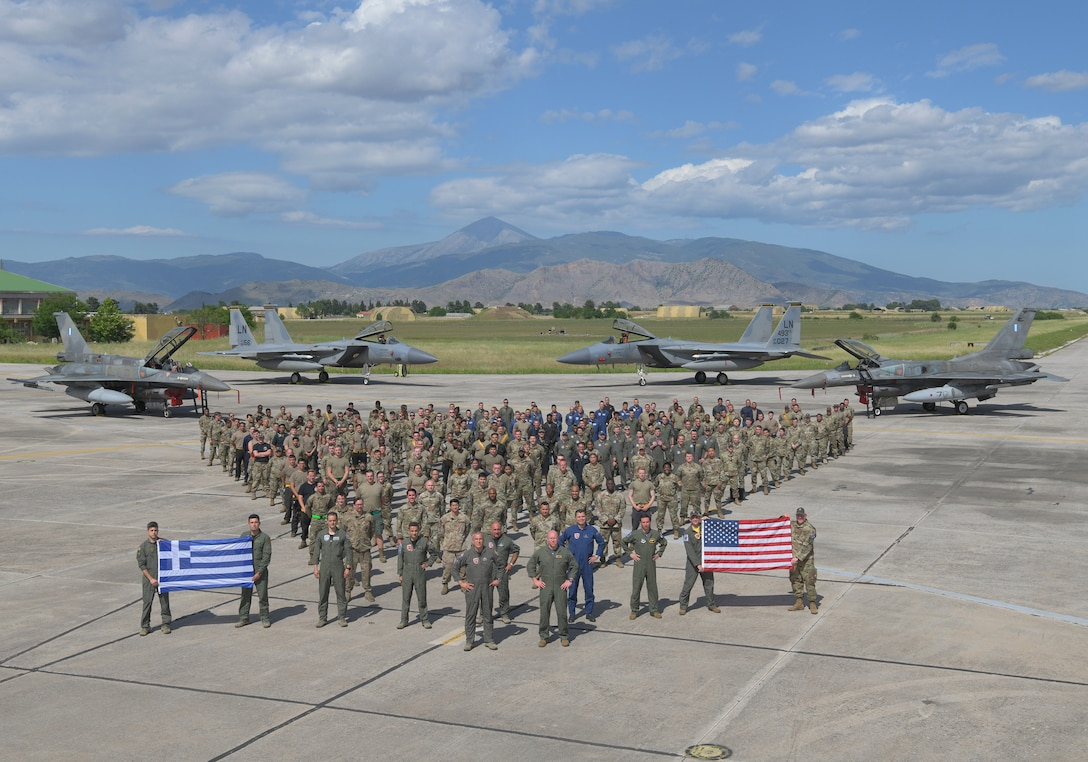 U.S. Air Force and Hellenic Air Force personnel join together at the conclusion of exercise Astral Knight, May 21, 2021. The 48th Fighter Wing trained with military forces from Albania, Croatia, Greece, Italy, and Slovenia as well as U.S. units from around European Command enhancing the readiness, strength and cohesion of these alliances. (U.S. Air Force photo by Tech. Sgt. Alex Fox Echols III)