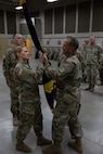 Soldiers pass the unit colors during a change of command ceremony