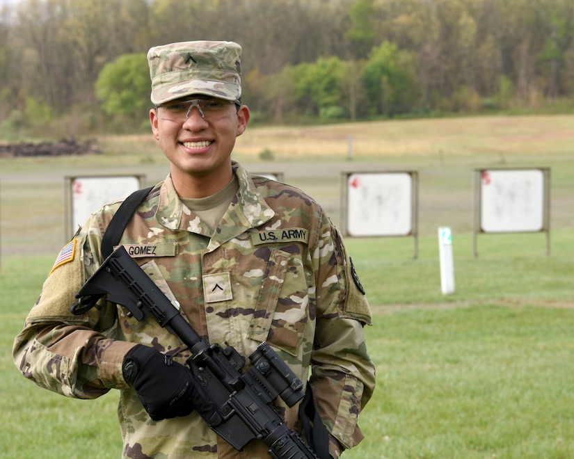 U.S. Army Pfc. Daniel Gomez, interior electrician with the 1436th Engineer Company, Michigan Army National Guard, poses for a photo during rifle qualification at Fort Custer Training Center in Augusta, Michigan