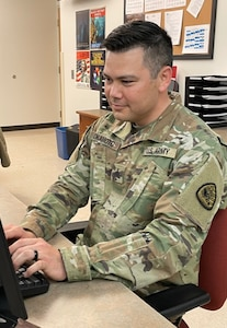 Soldier at a computer