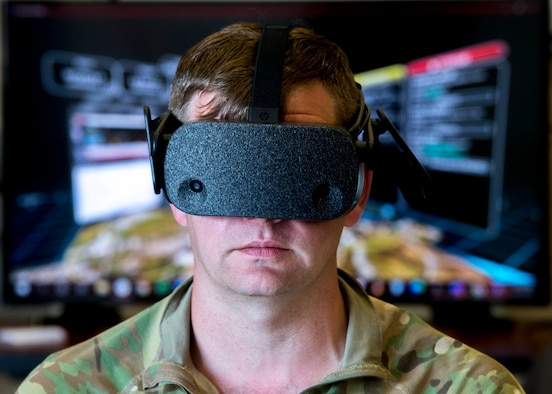 U.S. Air Force Master Sgt. Lee Bostson, 621st Contingency Response Group contingency location team lead, tests a new virtual reality system during Exercise Mobility Guardian 2021 at Alpena Combat Readiness Training Center, Alpena, Michigan, May 17, 2021. Mobility Guardian 2021 includes Air Mobility Command's first large-scale training on Agile Combat Employment and Advanced Battle Management System through use of Tactical Data Link. (U.S. Air Force photo by Senior Airman Lawrence Sena)