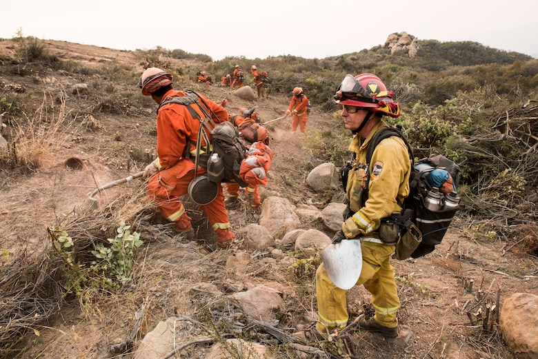 California Department of Corrections inmate fire fighters clear a fire line near Santa Barbara, California, Dec 11, 2017. The inmates were brought in to help fight the Thomas Fire. The fire started on Dec. 4, 2017 in Santa Paula, near Thomas Aquinas College. Driven by Santa Ana winds gusting up to 70 mph, the flames screamed across the hillsides toward Ojai, Ventura and Santa Barbara. (U.S. Air Force photo/Master Sgt. Brian Ferguson)