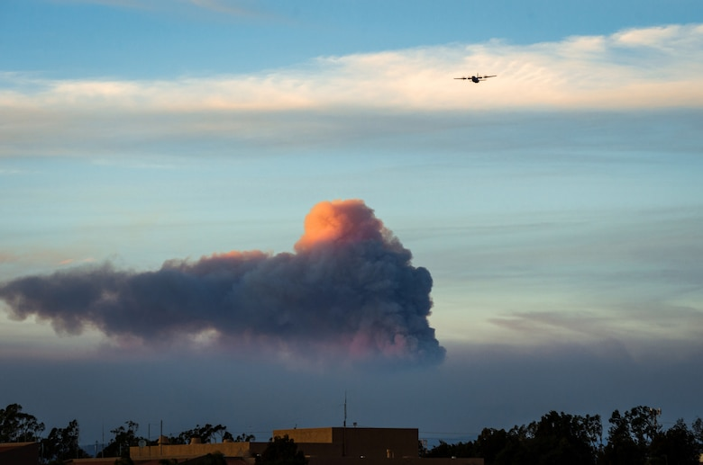 A C-130J of the 146th Airlift Wing, which carries the Modular Airborne Fire Fighting System (MAFFS), returns to Channel Islands Air National Guard Base in Port Hueneme, California, after dropping flame retardant chemicals on the Thomas Fire burning in Ventura and Santa Barbara Counties, Dec. 9, 2017. (U.S. Air Force photo by J.M. Eddins Jr.)
