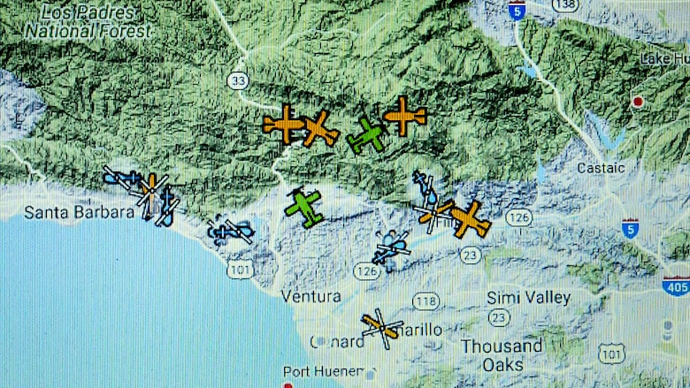 A computer display at the 146th Airlift Wing at Channel Islands Air National Guard Base in Port Hueneme, California, shows the position of aircraft performing aerial firefighting operations to combat the Thomas Fire in Ventura and Santa Barbara Counties, Dec. 10, 2017. (U.S. Air Force photo by J.M. Eddins Jr.)