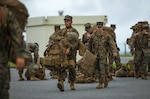 U.S. Marines with Marine Wing Support Squadron (MWSS) 172, unload gear during an Alert Contingency Marine Air Ground Task Force (ACM) drill at Marine Corps Air Station Futenma, Okinawa, Japan, May 21, 2021. The ACM exercise is a simulated crisis response drill that must be executed within 24 hours to prepare the Marines of 1st MAW to mitigate emergencies, provide humanitarian aid, and/ or counter threats to U.S. national interests within the Indo-Pacific region.
