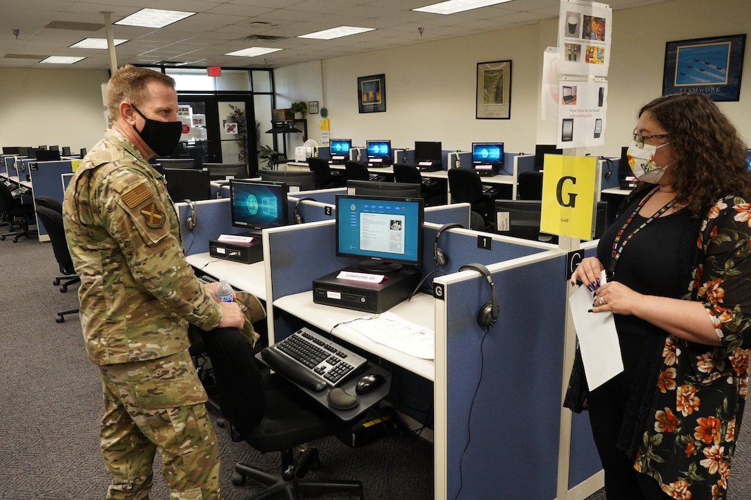 Chief Master Sgt. Michael Morgan learns about the DLIELC learning center.