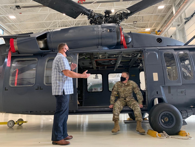 Chief Master Sgt. Michael Morgan sits in a helicopter at the IAAFA hangar May 10, 2021.