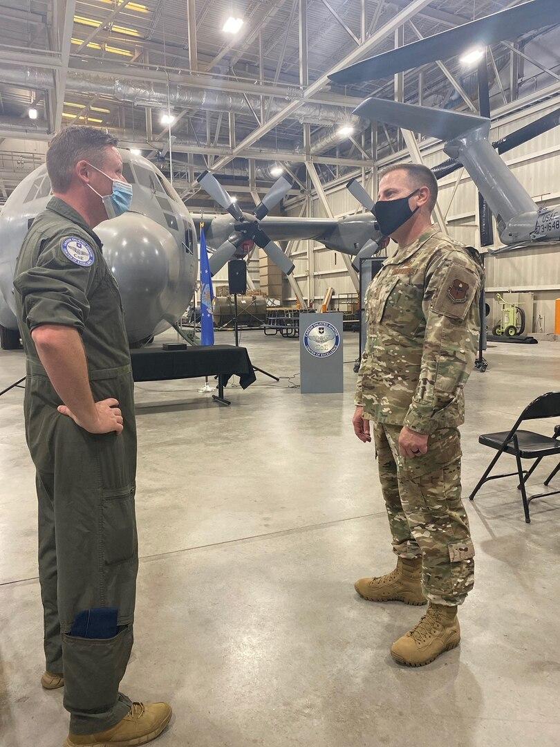 Chief Morgan talks with Master Sgt. Dalton at the CEA COE.