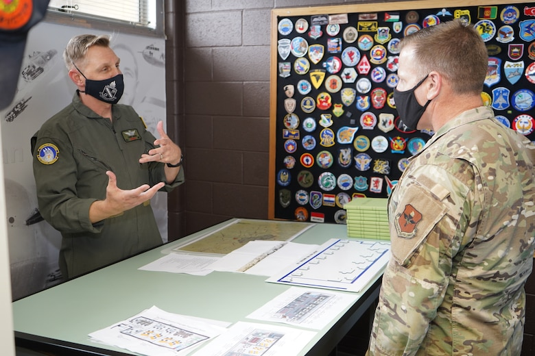 Chief Master Sgt. Michael Morgan listens to a briefing at the DLIELC Aviation Language Training Center at JBSA-Lackland, Texas.