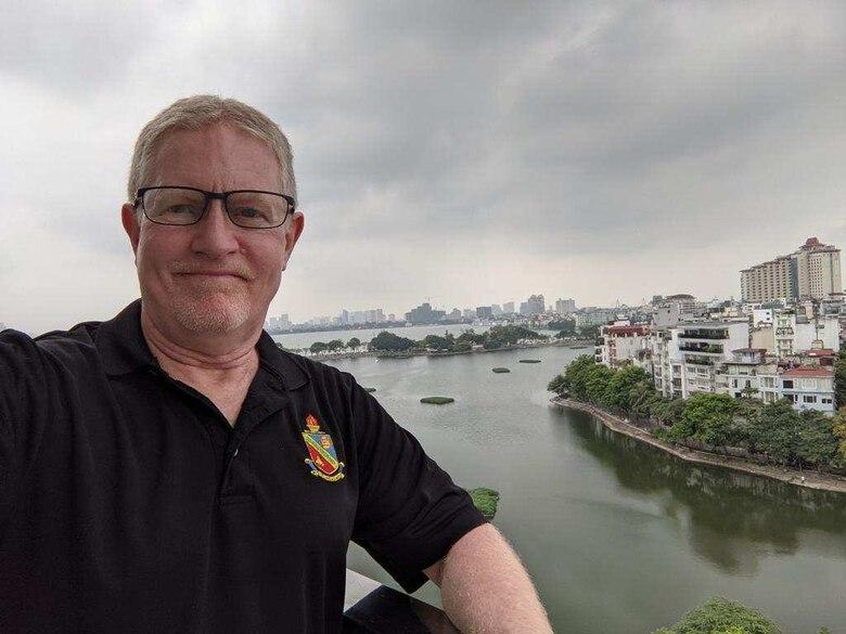 DLIELC instructor Phil Reed shown in scenic photo in Hanoi, Vietnam.