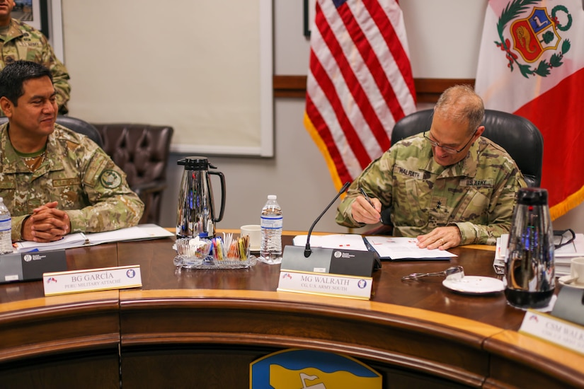 Maj. Gen. Daniel R. Walrath, U.S. Army South commanding general, signs minutes during the sixth annual U.S., Peru army-to-army staff talks, May 20, at the Army South headquarters, Fort Sam Houston, Texas.