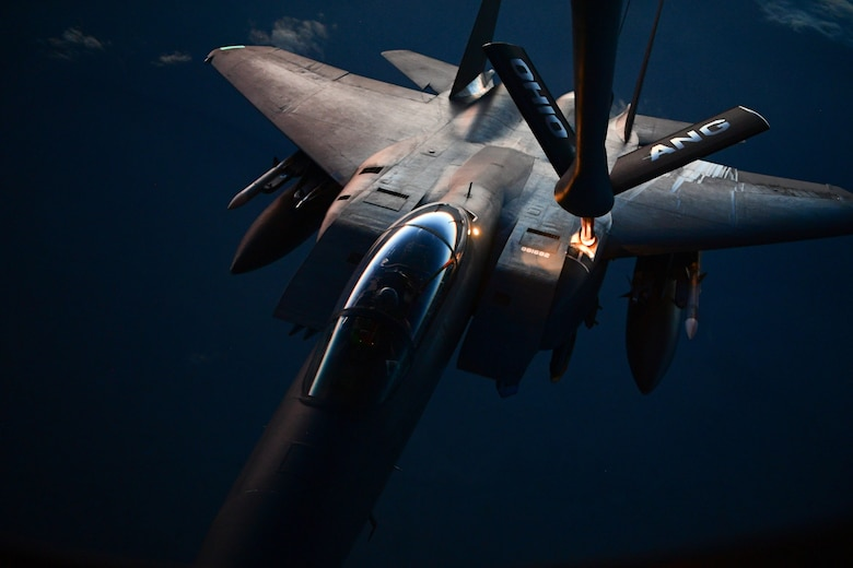 A U.S. Air Force F-15 Eagle receives fuel from a KC-135 Stratotanker assigned to the 340th Expeditionary Air Refueling Squadron during a refueling mission above Iraq March 16, 2018. The 340th EARS is assigned to the 379th Expeditionary Operations Group and supports various operations in countries such as Iraq, Syria and Afghanistan. (U.S. Air Force Photo by Tech. Sgt. Paul Labbe)