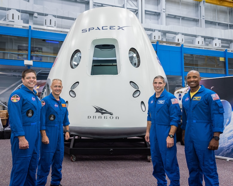 Commercial Crew Astronauts with the Boeing CST-100 and SpaceX Dragon mockups.  Photo Date: August 2, 2018.  Location: Building 9NW - SVMTF.  Photographer: Robert Markowitz