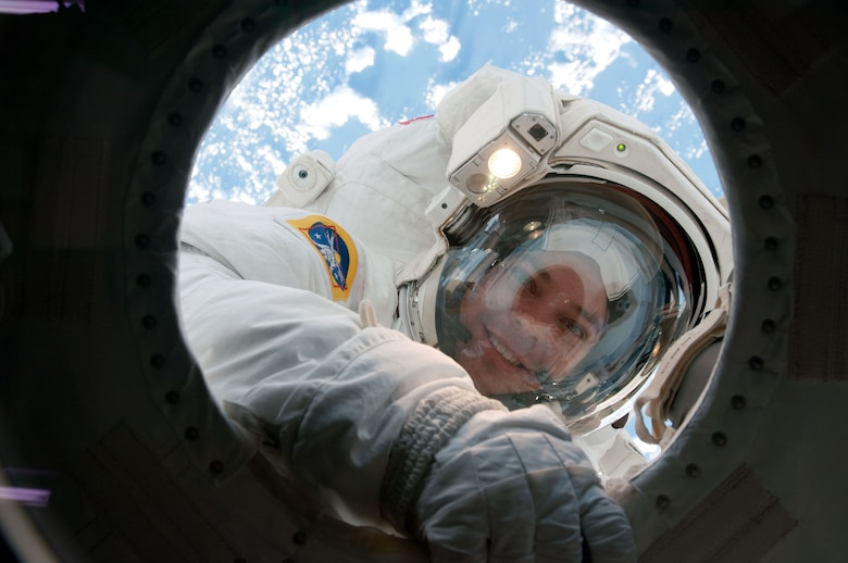 NASA astronaut Robert Behnken, STS-130 mission specialist, takes a break in the mission's second session of extravehicular activity (EVA) for construction and maintenance on the International Space Station in February of 2010 to allow air scrubbers to remove CO2 that had built up in his space suit. During the five-hour, 54-minute spacewalk, Behnken and astronaut Nicholas Patrick connected two ammonia coolant loops, installed thermal covers around the ammonia hoses, outfitted the Earth-facing port on the Tranquility node for the relocation of its Cupola, and installed handrails and a vent valve on the new module. (Photo/NASA)