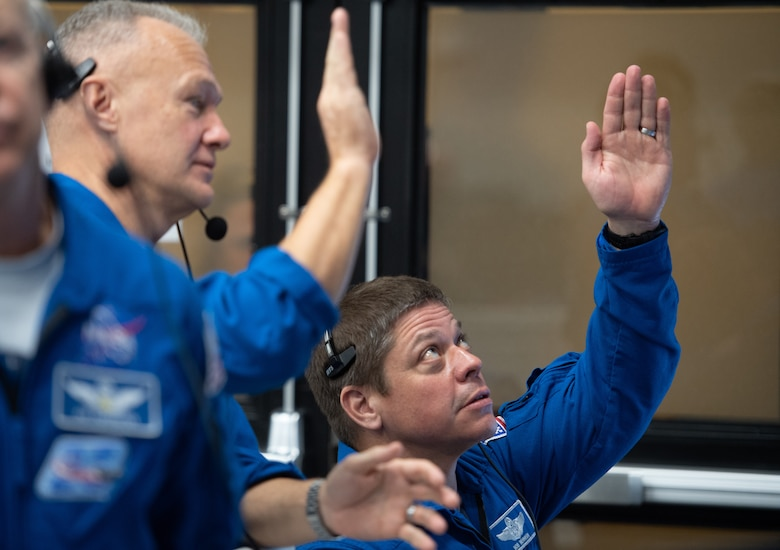 NASA astronauts Doug Hurley, left, and Bob Behnken, right, who are assigned to fly on the crewed Demo-2 mission, watch the launch of a SpaceX Falcon 9 rocket carrying the company's Crew Dragon spacecraft on the Demo-1 mission from firing room four of the Launch Control Center, Saturday, March 2, 2019 at the Kennedy Space Center in Florida. The Demo-1 mission will be the first launch of a commercially built and operated American spacecraft and space system designed for humans as part of NASA's Commercial Crew Program. The mission will serve as an end-to-end test of the system's capabilities.