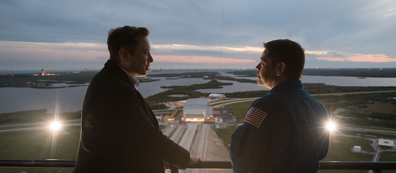 SpaceX CEO and Chief Designer Elon Musk, left, speaks with NASA astronaut Bob Behnken on the fixed service structure of Launch Complex 39A during a tour before the early Sunday morning launch of the Demo-1 mission, Friday, March 1, 2019 at the Kennedy Space Center in Florida. The Demo-1 mission launched at 2:49am ET on Saturday, March 2 and was the first launch of a commercially built and operated American spacecraft and space system designed for humans as part of NASA's Commercial Crew Program. The mission will serve as an end-to-end test of the system's capabilities. Behnken and fellow NASA astronaut Doug Hurley are assigned to fly onboard Crew Dragon for the Demo-2 mission. Photo Credit: (NASA/Joel Kowsky)