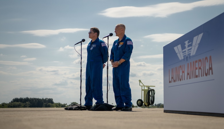NASA astronauts Robert Behnken, left, and Douglas Hurley speak to members of the media after arriving at the Launch and Landing Facility at NASA's Kennedy Space Center ahead of SpaceX's Demo-2 mission, Wednesday, May 20, 2020, in Florida. NASA's SpaceX Demo-2 mission is the first launch with astronauts of the SpaceX Crew Dragon spacecraft and Falcon 9 rocket to the International Space Station as part of the agency's Commercial Crew Program. The flight test will serve as an end-to-end demonstration of SpaceX's crew transportation system. Behnken and Hurley are scheduled to launch at 4:33 p.m. EDT on Wednesday, May 27, from Launch Complex 39A at the Kennedy Space Center. A new era of human spaceflight is set to begin as American astronauts once again launch on an American rocket from American soil to low-Earth orbit for the first time since the conclusion of the Space Shuttle Program in 2011.  Photo Credit: (NASA/Bill Ingalls)