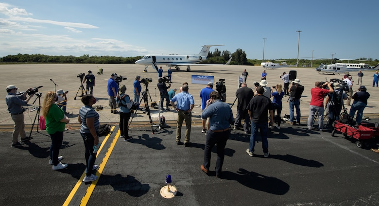 NASA Administrator Jim Bridenstine and Kennedy Space Center Director Bob Cabana greet NASA astronauts Robert Behnken, left, and Douglas Hurley as they arrive at the Launch and Landing Facility at NASA's Kennedy Space Center ahead of SpaceX's Demo-2 mission, Wednesday, May 20, 2020, in Florida. NASA's SpaceX Demo-2 mission is the first launch with astronauts of the SpaceX Crew Dragon spacecraft and Falcon 9 rocket to the International Space Station as part of the agency's Commercial Crew Program. The flight test will serve as an end-to-end demonstration of SpaceX's crew transportation system. Behnken and Hurley are scheduled to launch at 4:33 p.m. EDT on Wednesday, May 27, from Launch Complex 39A at the Kennedy Space Center. A new era of human spaceflight is set to begin as American astronauts once again launch on an American rocket from American soil to low-Earth orbit for the first time since the conclusion of the Space Shuttle Program in 2011.  Photo Credit: (NASA/Bill Ingalls)