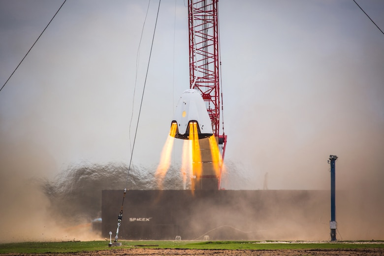 SpaceX performing a Propulsive Descent Landing with their Dragon capsule at the SpaceX Test Facility in McGregor, Texas