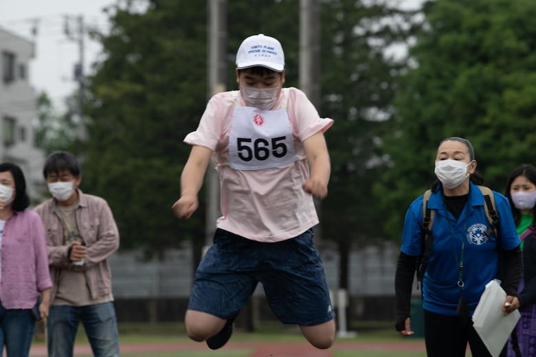 An athlete jumps during the Kanto Plains Special Olympics
