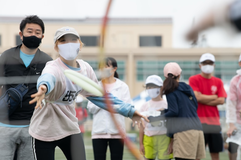An athlete throws a disk during the Kanto Plains Special Olympics