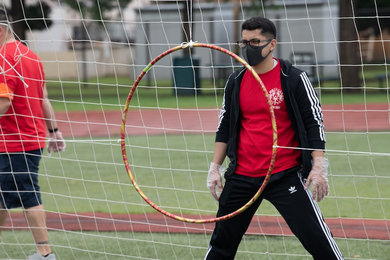 A volunteer waits to catch a disk during the Kanto Plains Special Olympics
