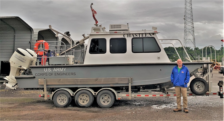 IN THE PHOTO, Mark Manning poses with the newly renamed survey vessel, the M/V Chasteen, named in honor of Darian Chasteen. Chasteen recently passed away, losing a hard-fought battle with cancer. While he is physically no longer with the district, his legacy will live on through stories and memories forever.