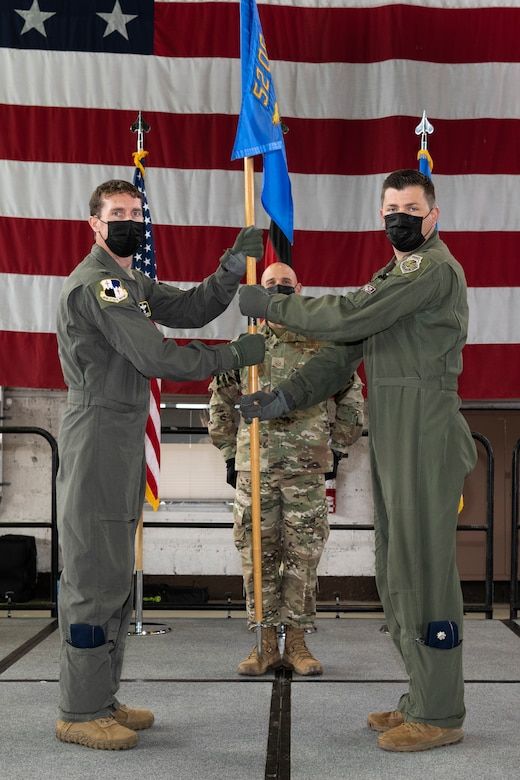 Guidon transfer during 52nd Operations Support Squadron change of command.
